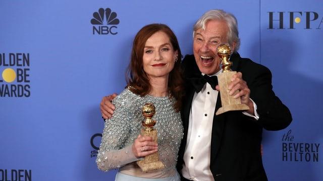 Isabelle Huppert und Paul Verhoeven mit Golden Globes