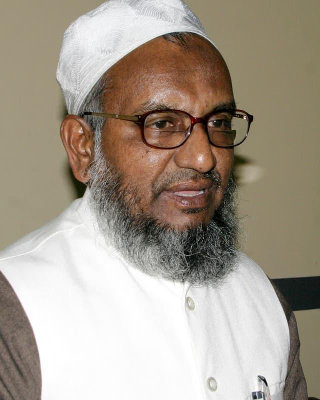Älterer Mann mit Brille und grauem Bart.