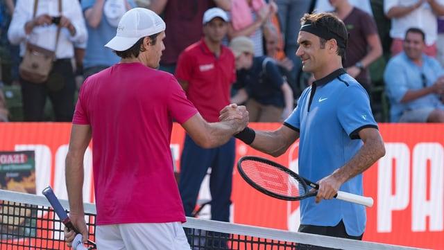 Purtret da Federer e Haas sin il plaz.