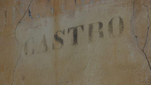 Inscripziun en ina chasa a Castro.