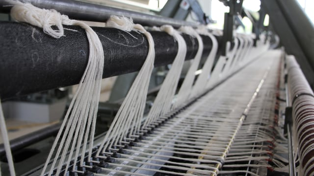 Teppichspulen und -fäden
