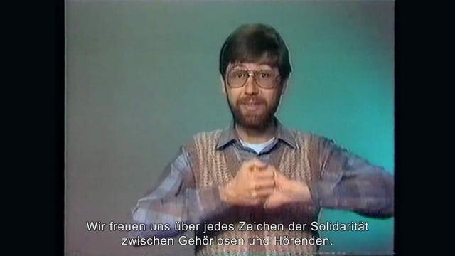 Markus Huser in einer Fernsehaufnahme mit Untertiteln