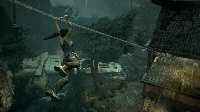 Ein Screenshot des Games «Tomb Raider» zeigt die Hauptfigur Lara Croft beim Abseilen.