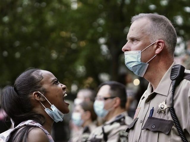 Minnesota protester expresses anger against a police officer.