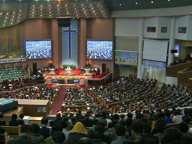 Südkoreaner beim Gottesdienst – die Menschen beten für den Frieden.