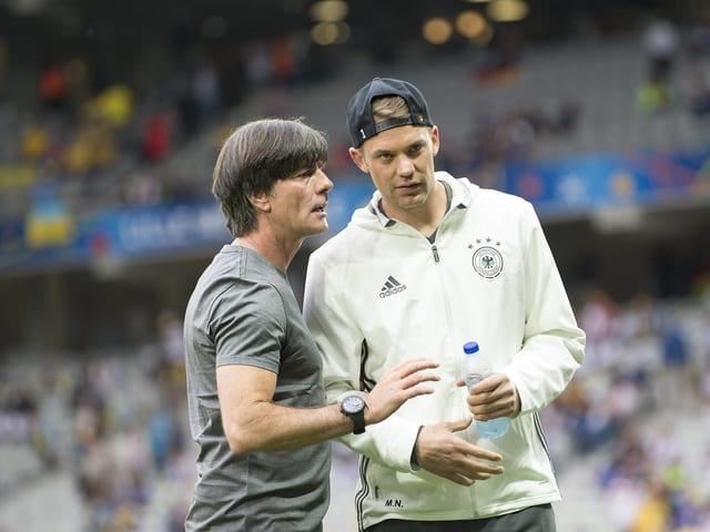 Manuel Neuer und Joachim Löw.