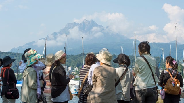 Turists asiats a Lucerna.