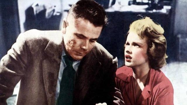 Die Filmszene, die nachkoloriert wurde, zeigt Glenn Ford und Anne Francis.
