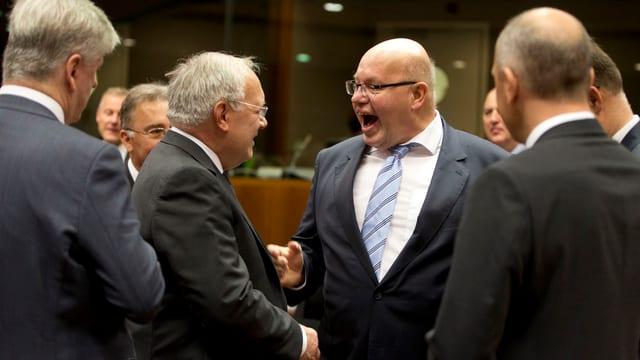 Bundesrat Schneider-Ammann und der deutsche Finanzminister Altmaier am Treffen in Brüssel.