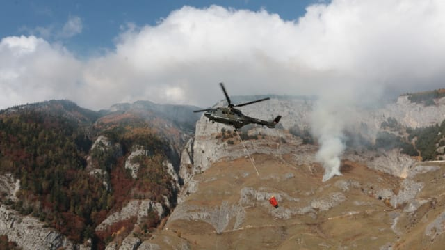Purtret dal helicopter dal tip Super-Puma en acziun.