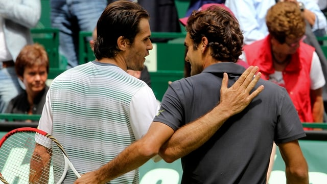 Tommy Haas (links) und Roger Federer.