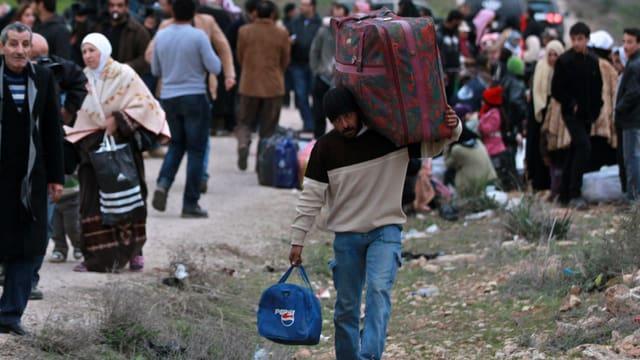 Syrer entfliehen dem Bürgerkrieg.