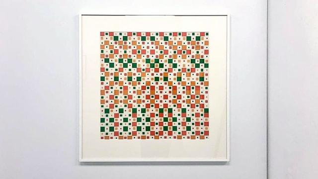 Verschieden grosse Quadrate in Grün und Orange.