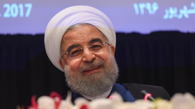 Irans Präsident Hassan Rohani lächelt.
