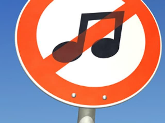 Ein Verbotschild mit einer Musiknote