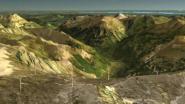 Visualisierung: Blick auf sechs Windräder im Hintergrund Berge und See