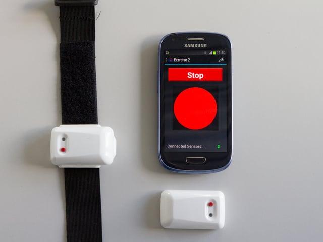 """Smartphone-App mit Button """"Stopp"""" und einem roten Kreis."""