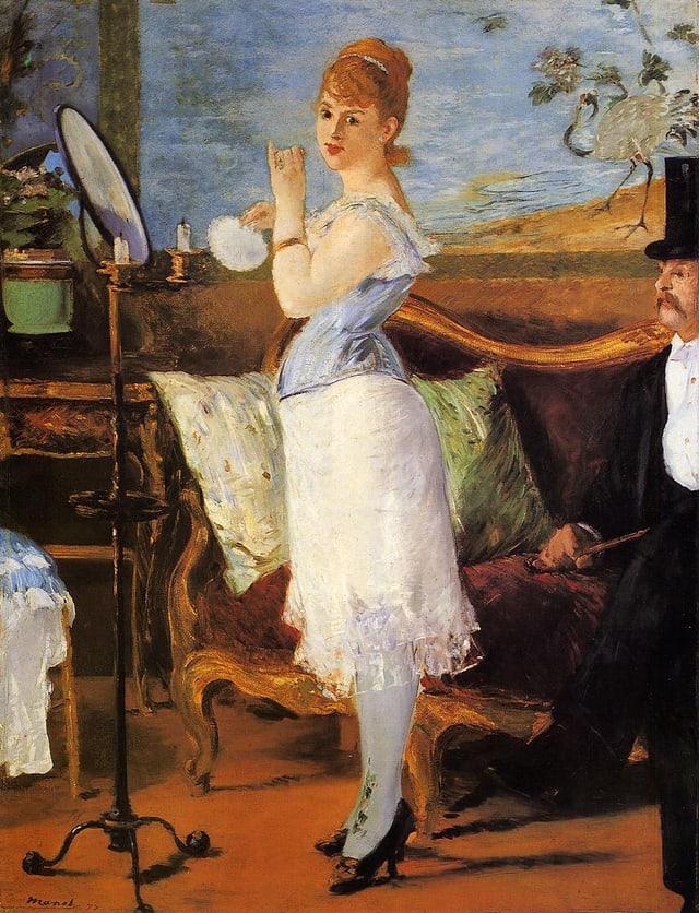 Eine Frau steht im Korsett an einer Staffelei