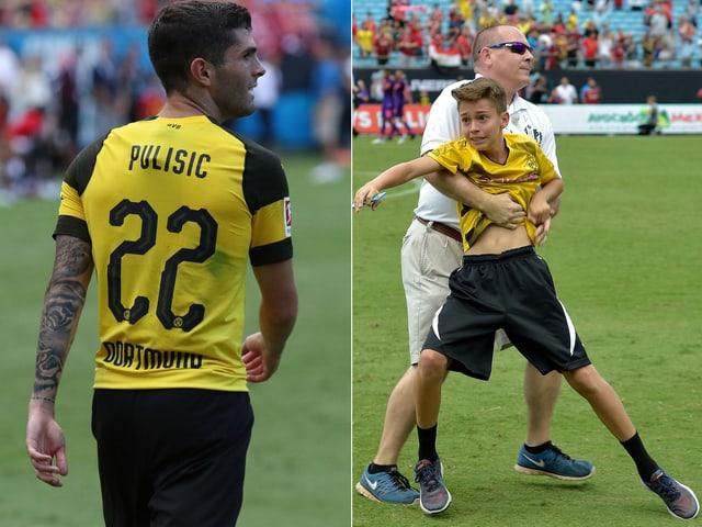 Christian Pulisic und ein kleiner Fan, der von einem Sicherheitsmann zurückgehalten wird