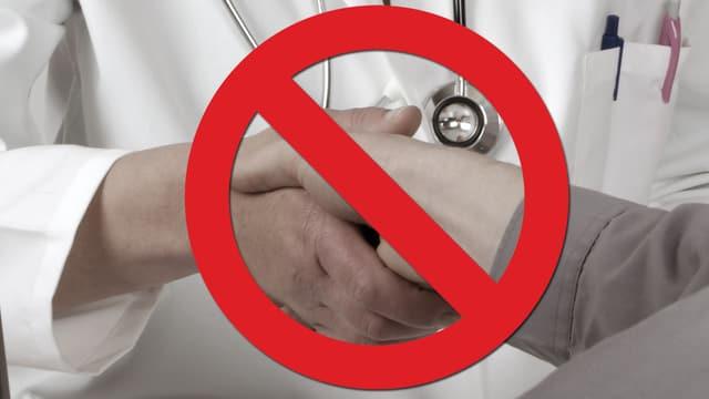 Verbotszeichen über einem Handschlag