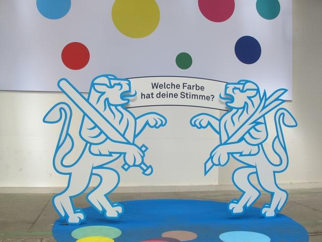 Farbige Punkte als Symbol für die Parteifarben, die Zürcher Wappentiere halten ein Banner mit der Frage: Welche Farbe hat deine Stimme?