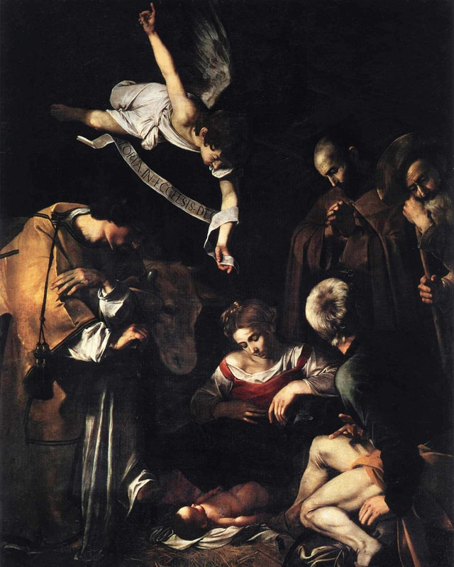 Eine Engel schwebt über der Krippenszene mit Baby Jesus.