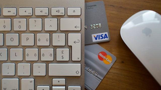 Tastatura da computer, mieur e duas cartas da credit sin ina maisa.