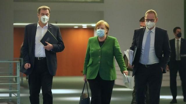 Markus Söder ed Angela Merkel.