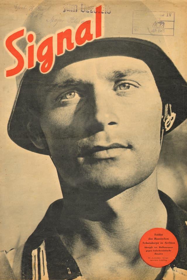 """Titelblatt einer alten Zeitschrift: Das Foto zeigt das verträumte dreinschauende Gesichte eines Soldaten. Darüber in Rot der Titel """"Signal"""""""