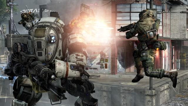 Zwei Piloten setzen einem gegnerischen Titan zu.