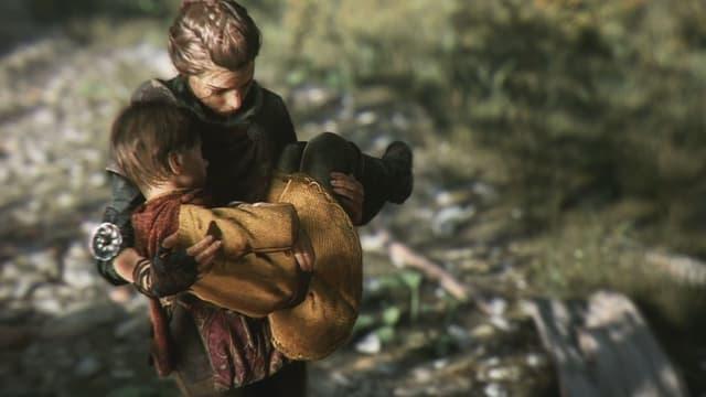 Amicia trägt ihren Bruder, da er krank ist.