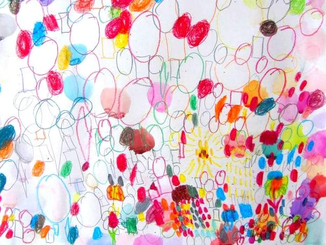 Auf einem Papier sind farbige Kreise gezeichnet, dazwischen Aquarellflecken.