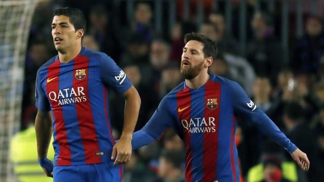 Die Barcelona-Stars Luis Suarez und Lionel Messi.