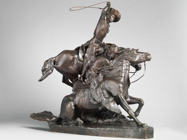 Cowboy schwingt Lasso - in Bronze