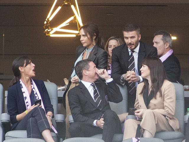 David Beckham (oben rechts) mit Frau Victoria.