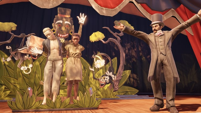 Ein Mann und eine Frau gefesselt auf einer Bühne.