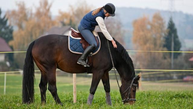 Eine Reiterin.