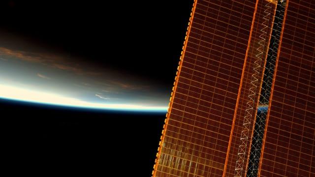 Sonnensegel, im Hintergrund die Erde.