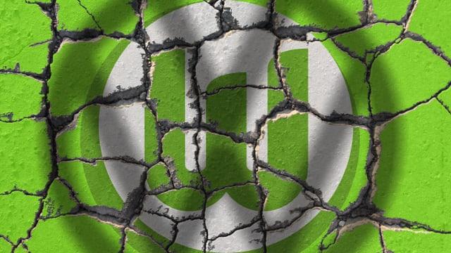 Wolfsburg-Klub-Logo auf bröselndem Beton