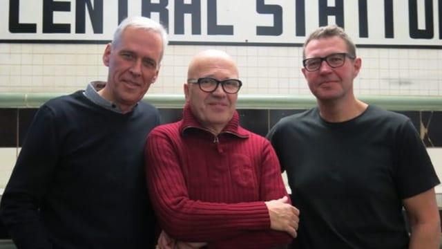 Portraitaufnahme der drei Organisatoren