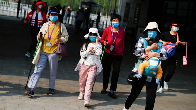 People wearing face masks arrive at the ticket area to visit the Mutianyu section of the Great Wall of China on the first day of the five-day Labour Day holiday following the coronavirus disease (COVID-19) outbreak, on the outskirts of Beijing, China May 1, 2020. REUTERS/Thomas Peter