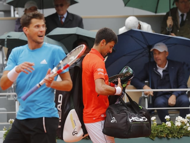 Dominic Thiem und Novak Djokovic.