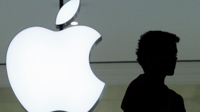 Apple-Logo mit Schattenfigur
