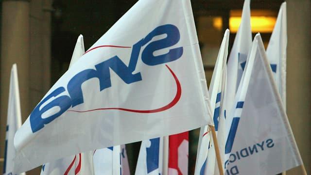 Bandieras dal sindicat Syna.