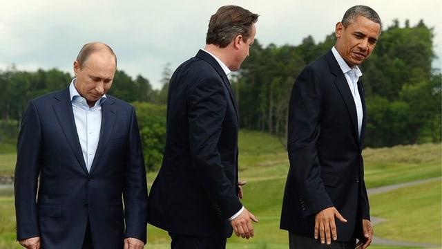 Wladimir Putin am G8-Gipfel in Lough Erne, Nordirland, im Juni 2013. David Cameron (GB) und Barak Obama (USA) drehen Putin den Rücken zu.