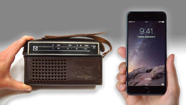 Alter Transistorradio und modernes Smartphone