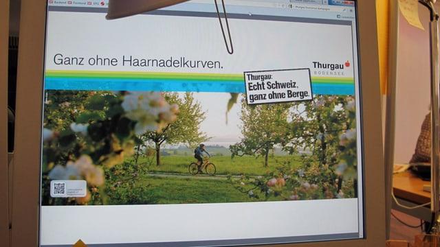Ein Bildschirm, welches ein Plakat der Kampagne zeigt