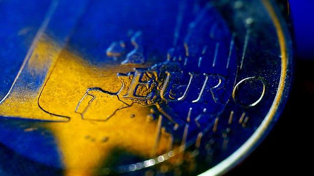 Ina munaida dad Euro cun ina staila.