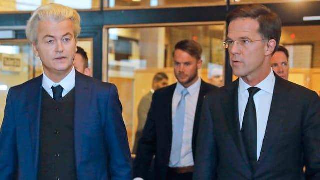 Ils dus favurits - il populist dretg Geert Wilders (san.) ed il primminister e dretgliberal Mark Rutte (dre.).