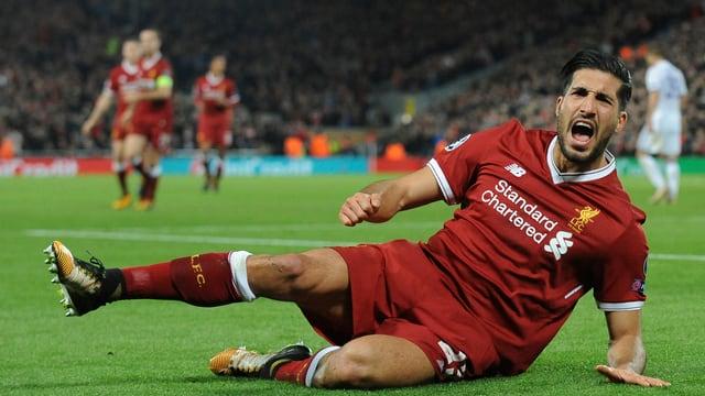 Emre Can bejubelt im Dress des FC Liverpool ein Tor.